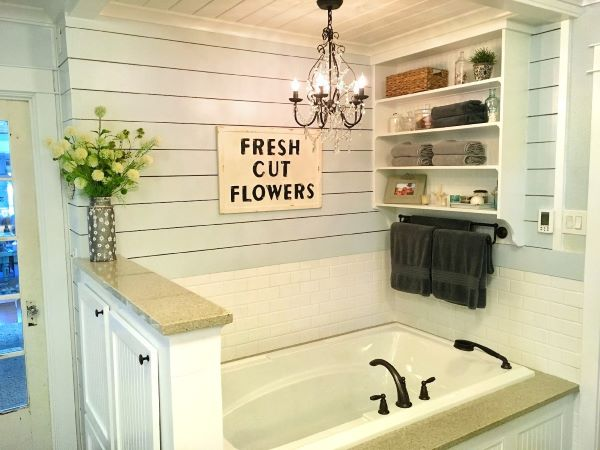 bathtub in bathroom with fresh cut flower sign
