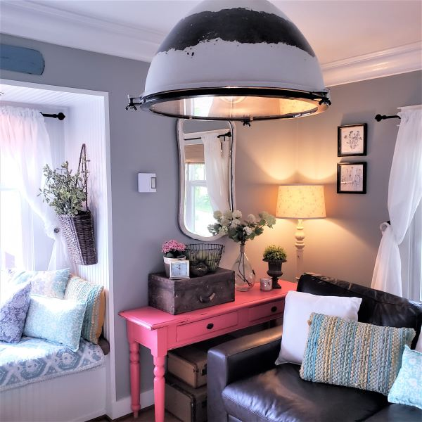 pendant lighting and pink table with gray walls
