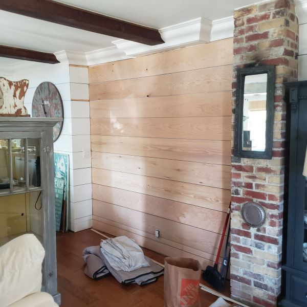 Shiplap being put on a living room wall