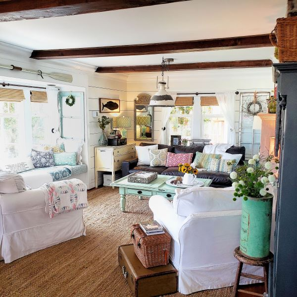 cottage living room with home decor and brightly colored furniture and pillows
