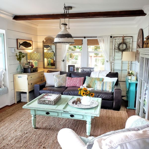 cottage living room with bright colored decorative pillows and furniture