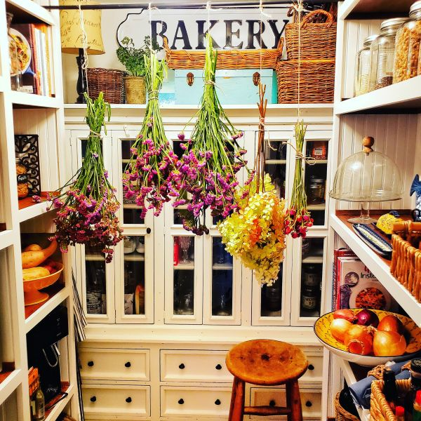 Walk-in pantry with hanging dried flowers