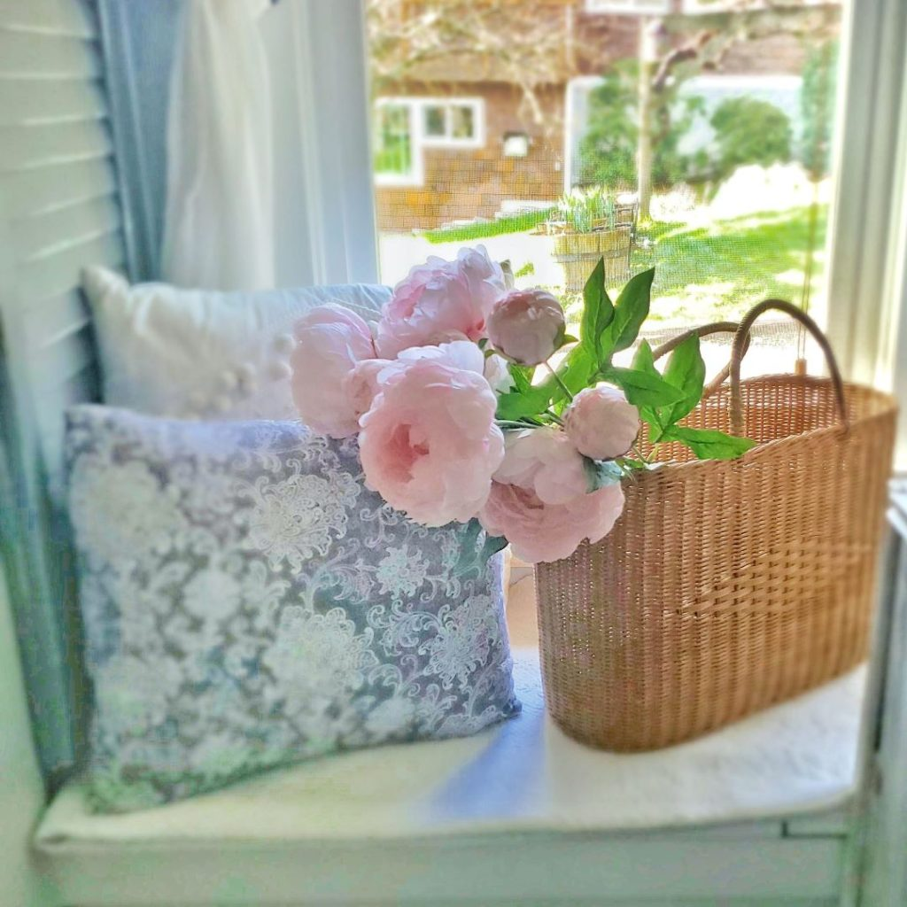 faux peonies in a basket
