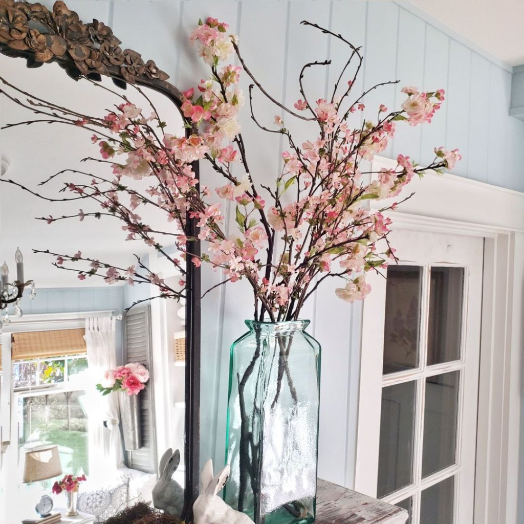 cherry blossom blooms on bedroom mantel