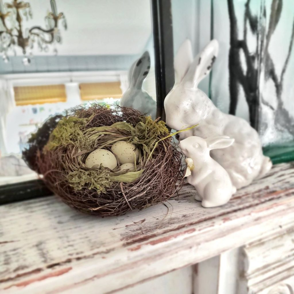 ceramic white bunny and nest with eggs on mantel