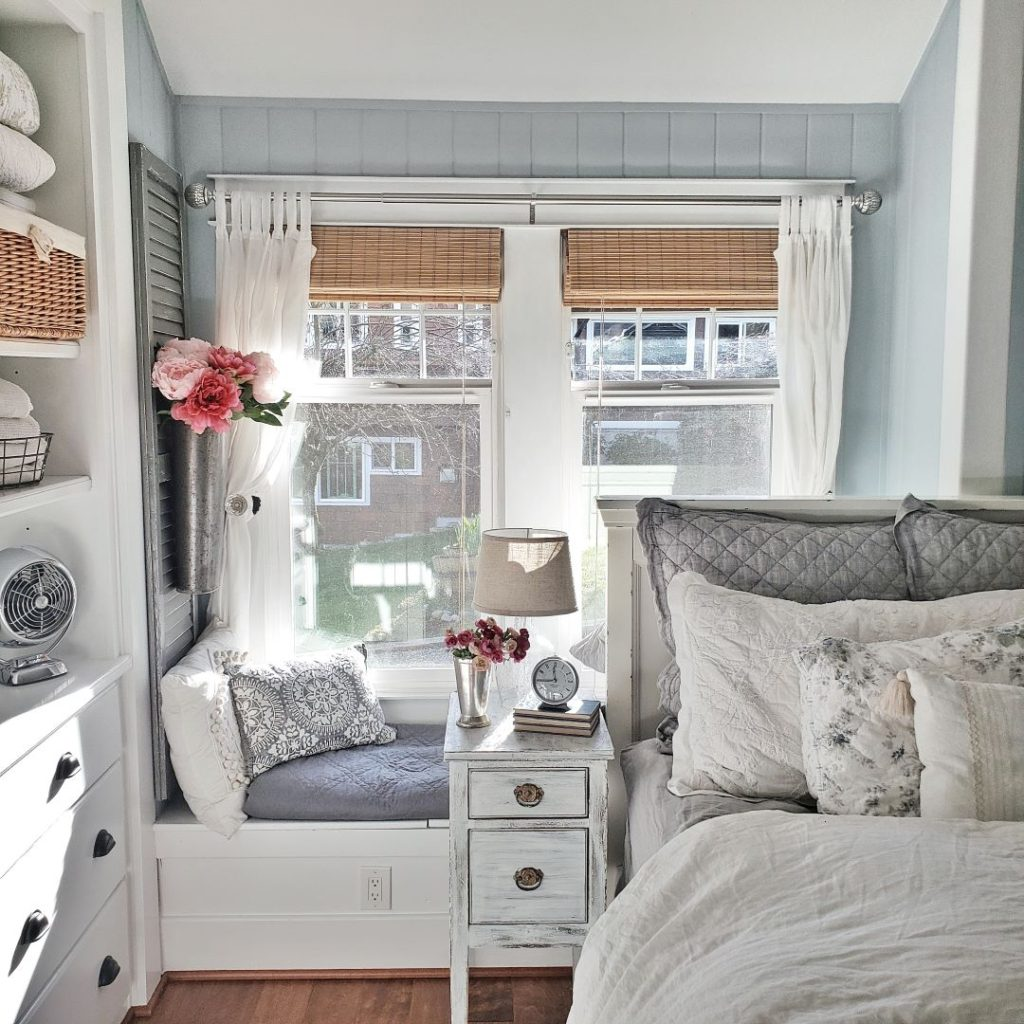 bedroom with bed and window seat
