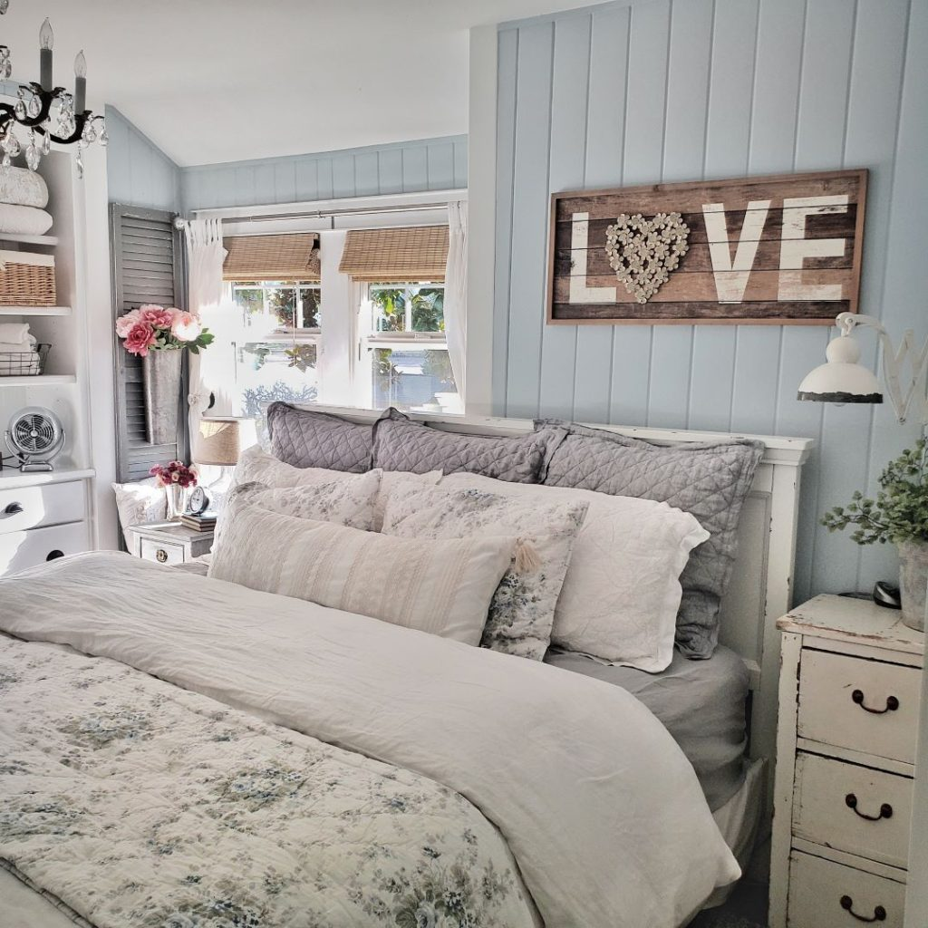 bedroom with spring bedding, love sign and windows