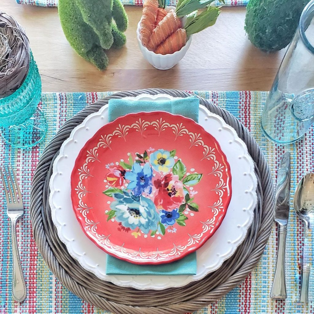 My Easter spring tablescape place setting, complete with floral plates from Pioneer Woman.