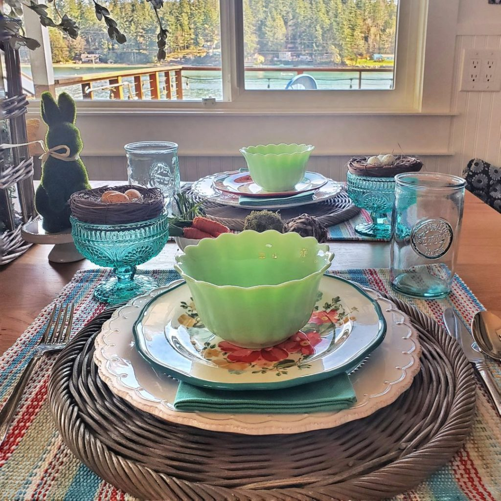 Colorful floral plates and stunning jade green bowls make up this gorgeous Easter place setting.