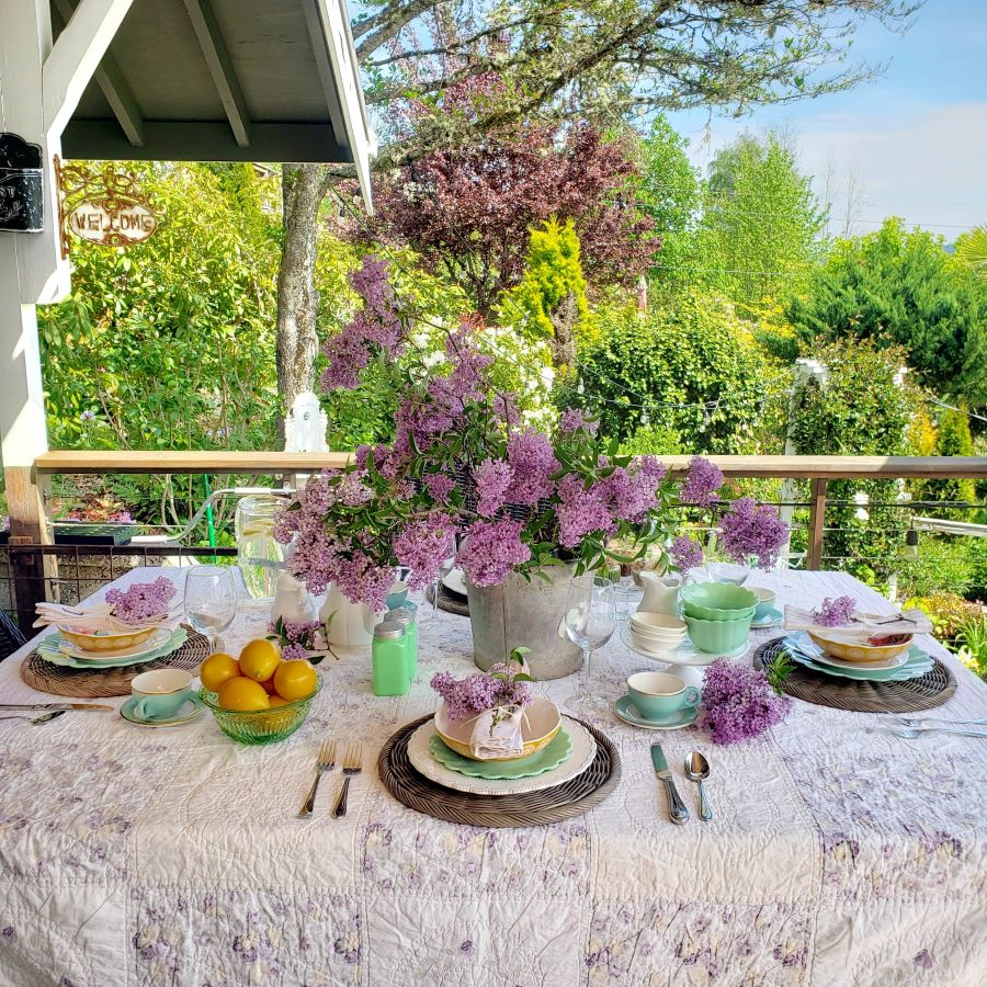 An outdoor spring tablescape full of lilacs