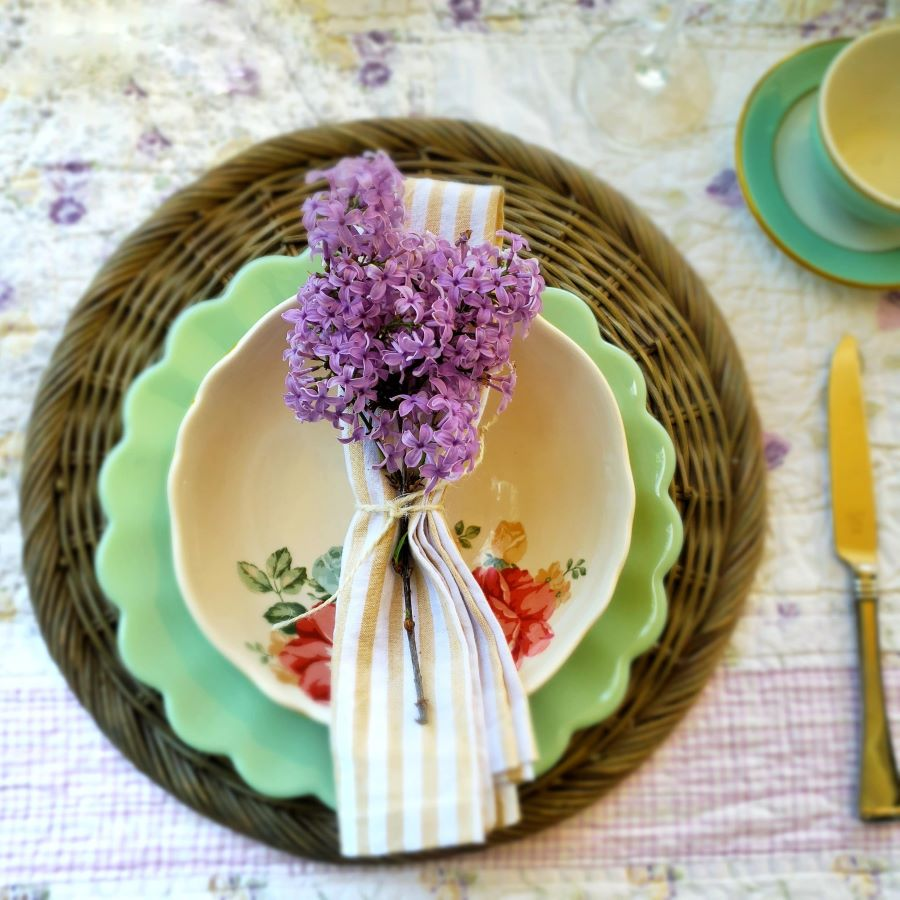 A spring place setting with lilacs