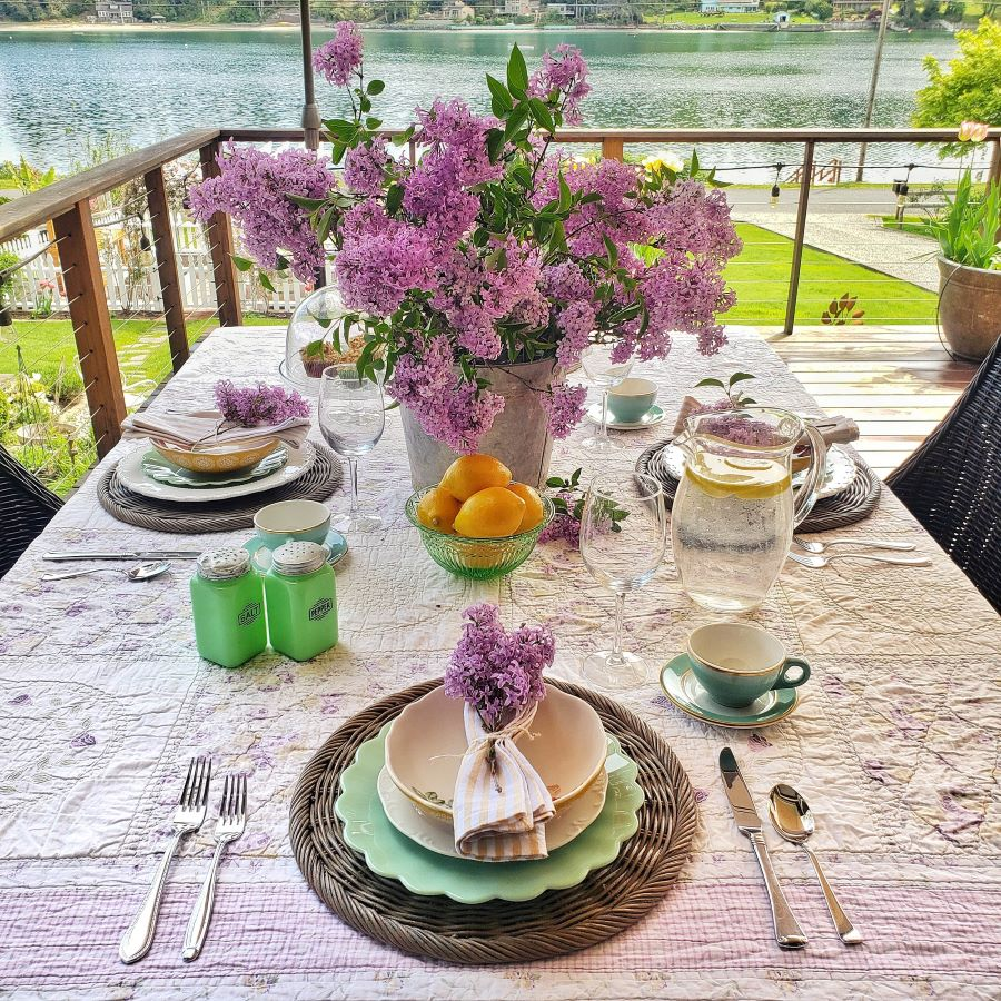 spring tablescape with a lilac centerpiece