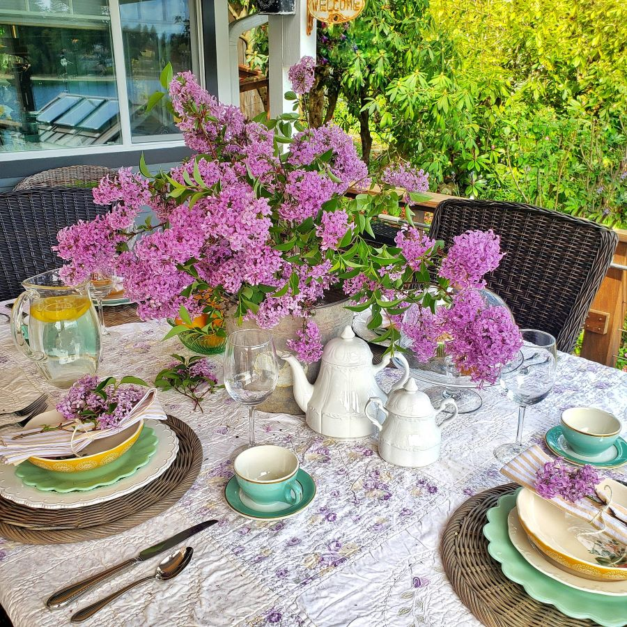 Lilac centerpiece on a spring tablescape