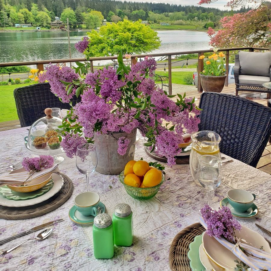 Spring tablescape out on the deck, complete with lilac centerpiece