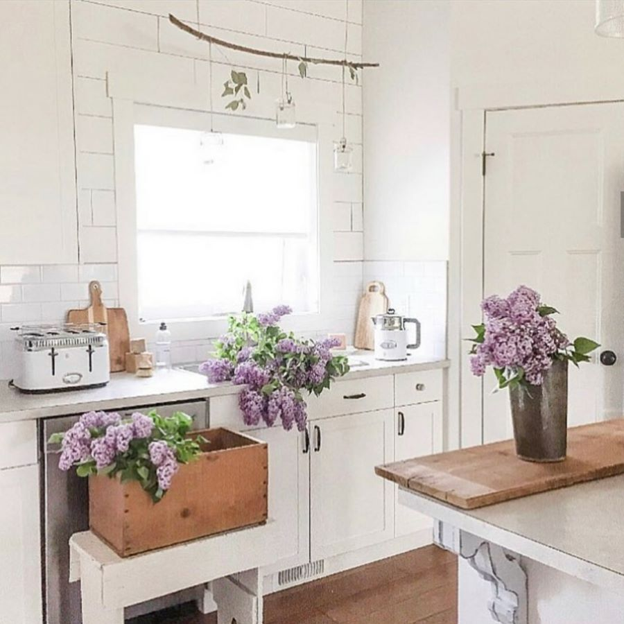 Lilacs in a white kitchen
