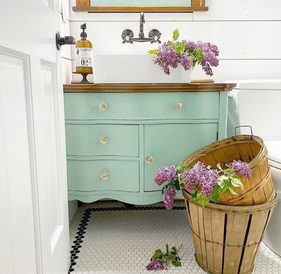 green vintage dresser vanity with lilacs in baskets