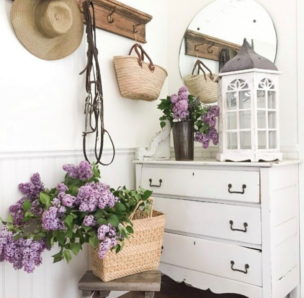 lilacs in a basket and white dresser