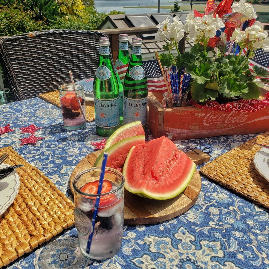 a perfectly patriotic tablescape with watermelon and patriotic decor