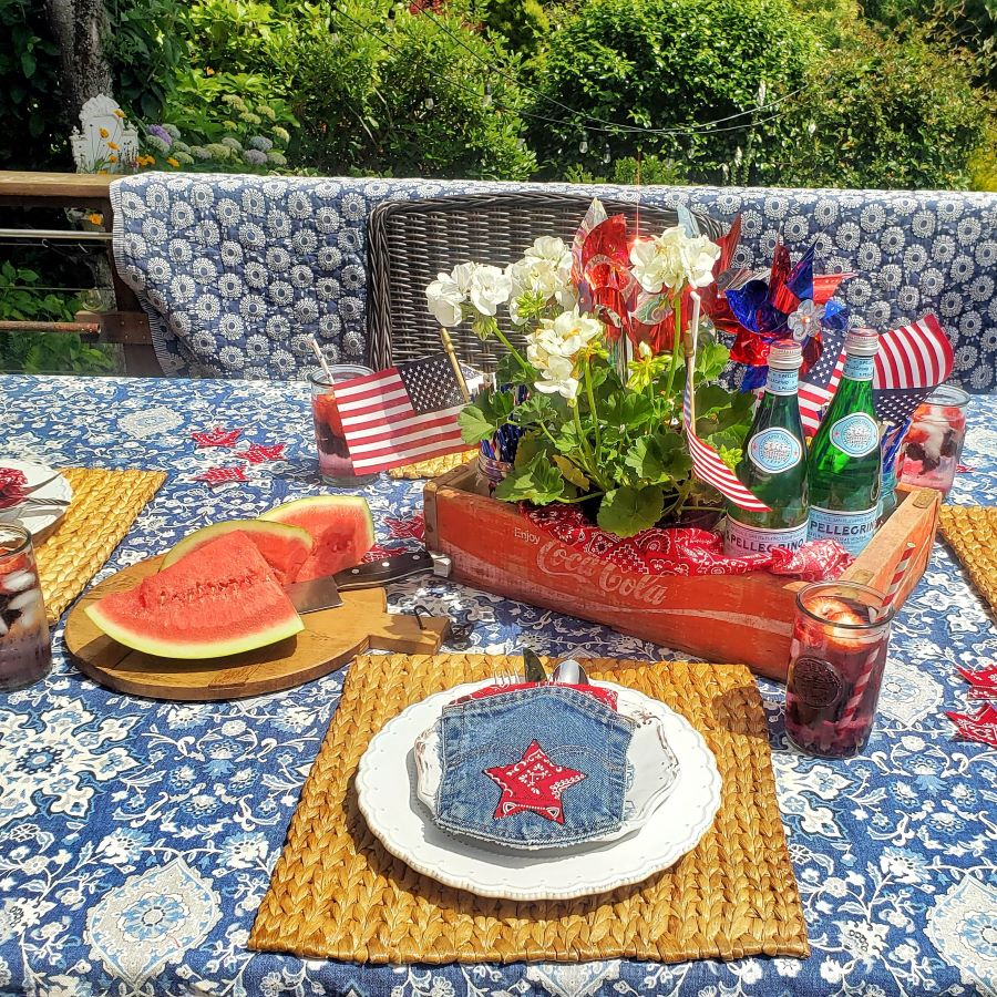 a perfectly patriotic tablescape decorated with watermelon and patriotic decor