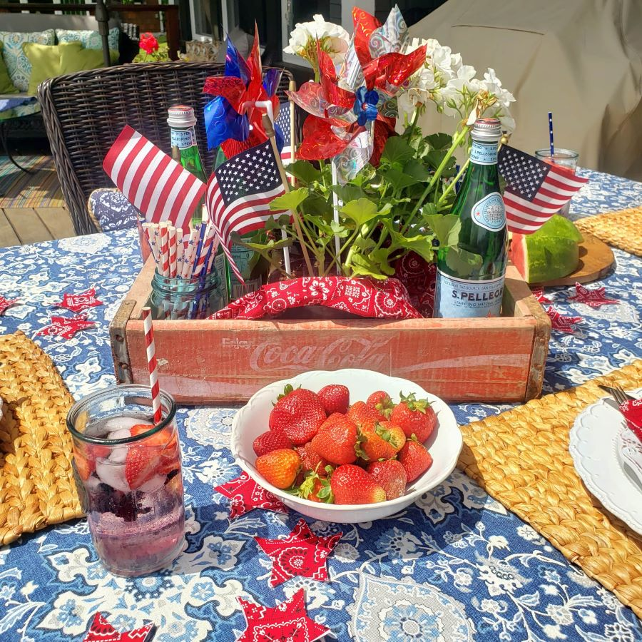 a perfectly patriotic tablescape with strawberries and patriotic decor