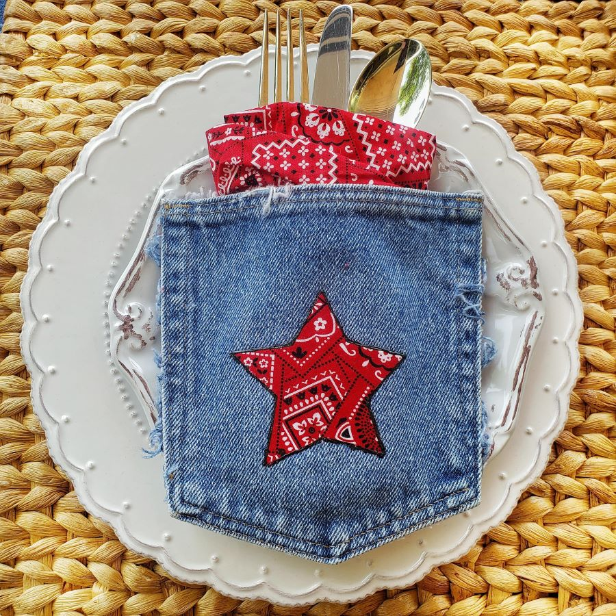 table setting with white dishes and a denim pocket with red bandana star