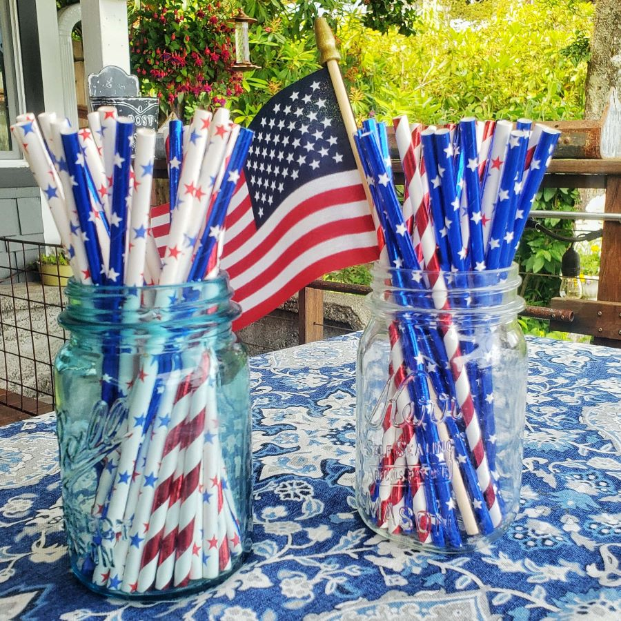American flag and red, white and blue straws in Mason jars