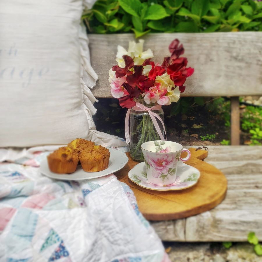 The rose traveling teacup with muffins and sweet peas in a mason jar