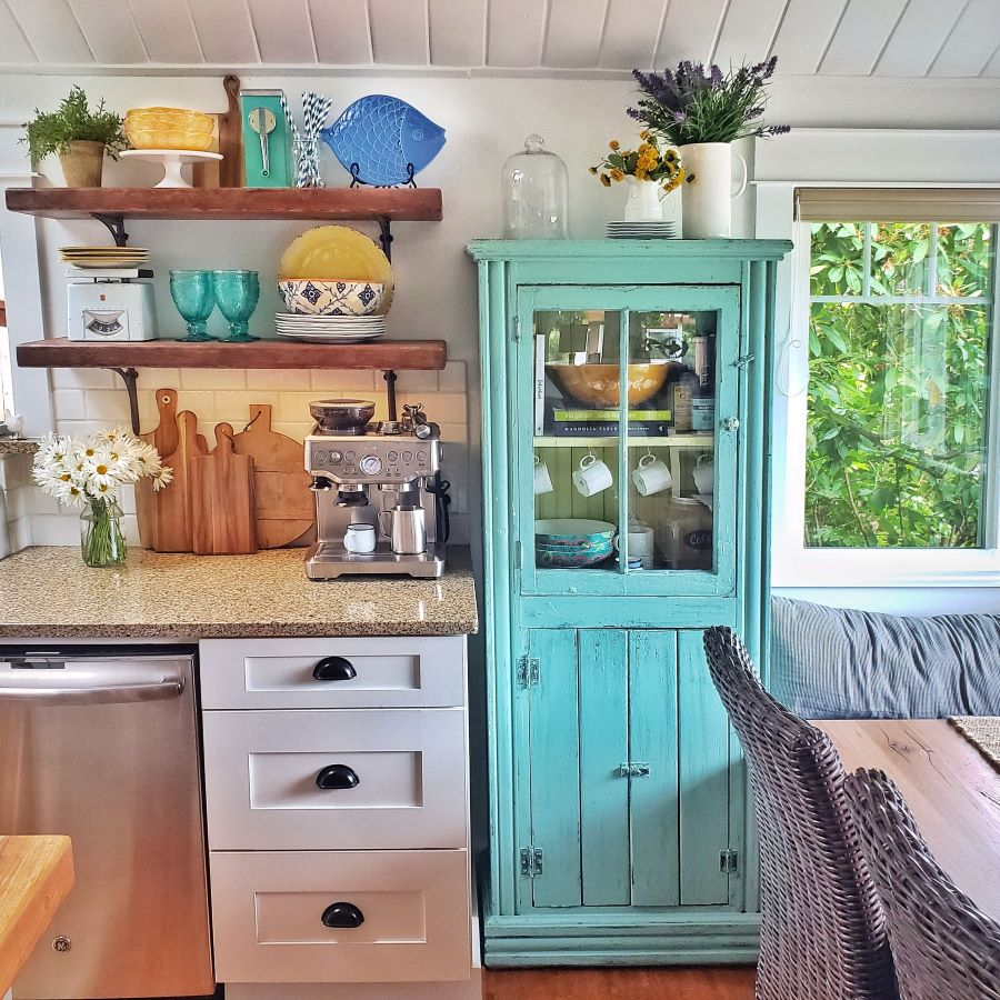 turquoise glass cabinet and open shelves
