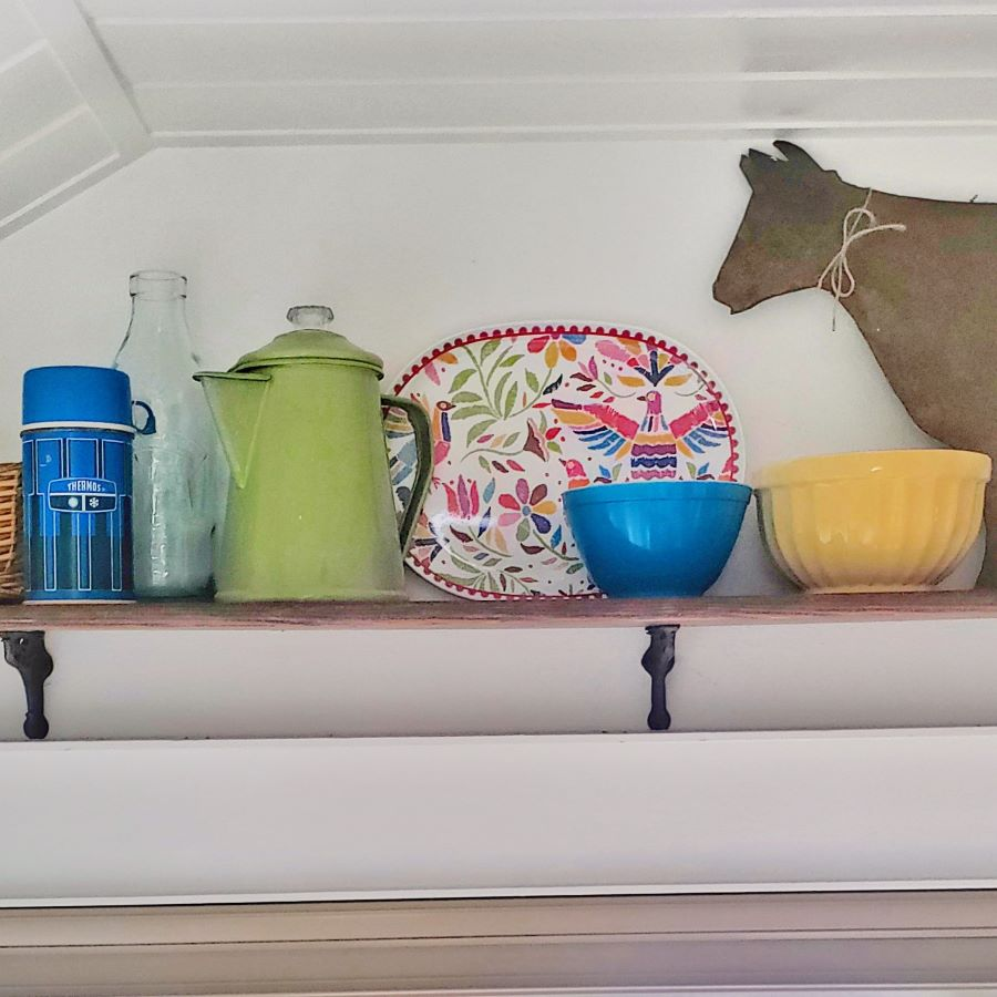 kitchen shelf with colorful dishes