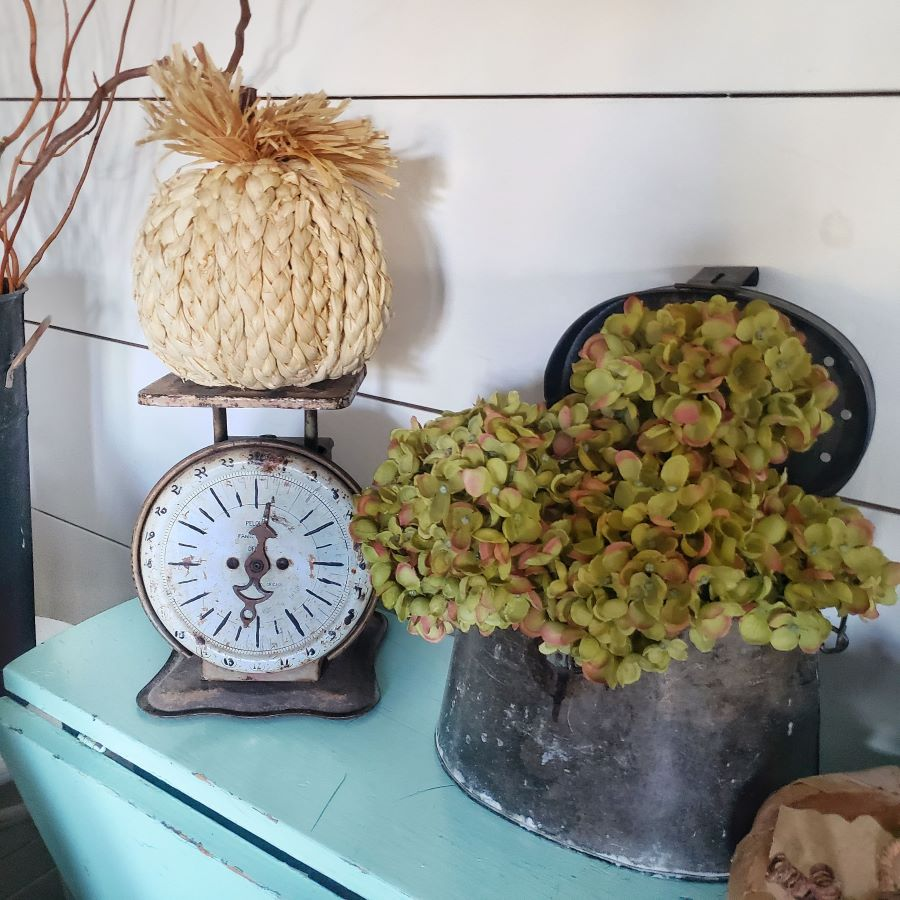 Fall vignette with vintage basket and scale.