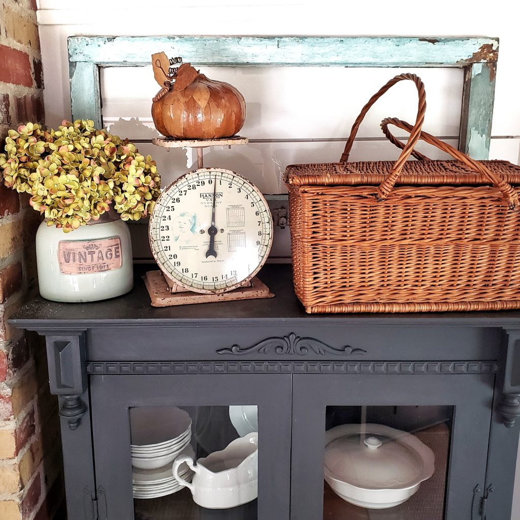 fall vignette with picnic basket and vintage finds.