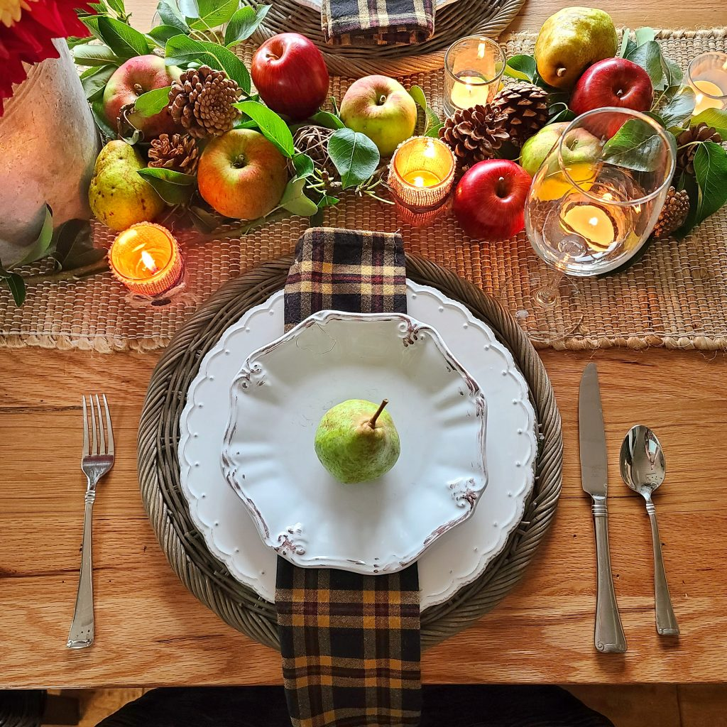 table setting with pear and white dishes