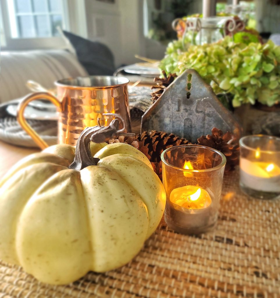 White pumpkins and tea candles