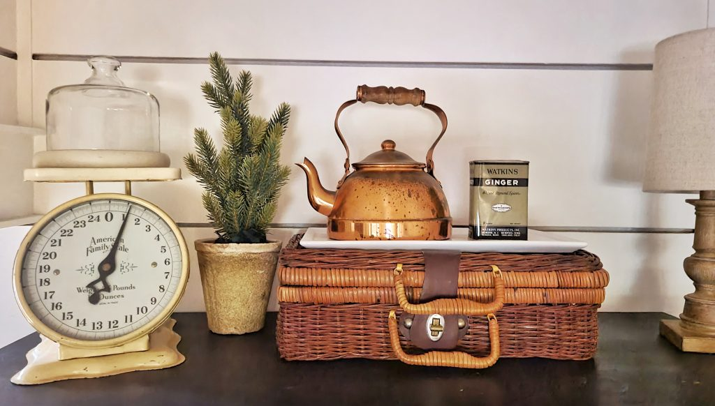 Kitchen vignette with wicker picnic basket and mini Christmas tree