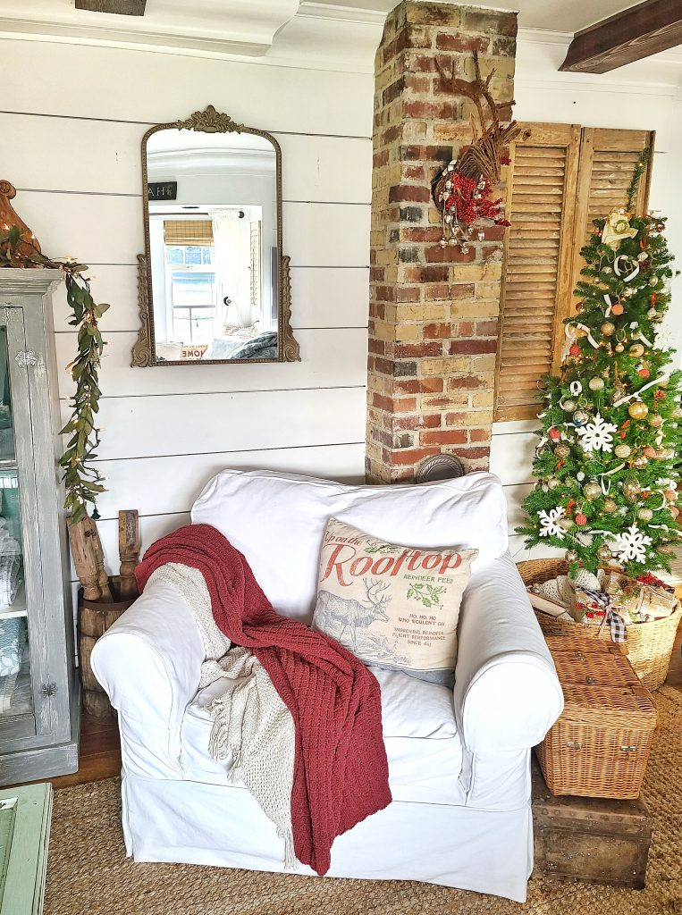 white slipcovered chair and Christmas tree