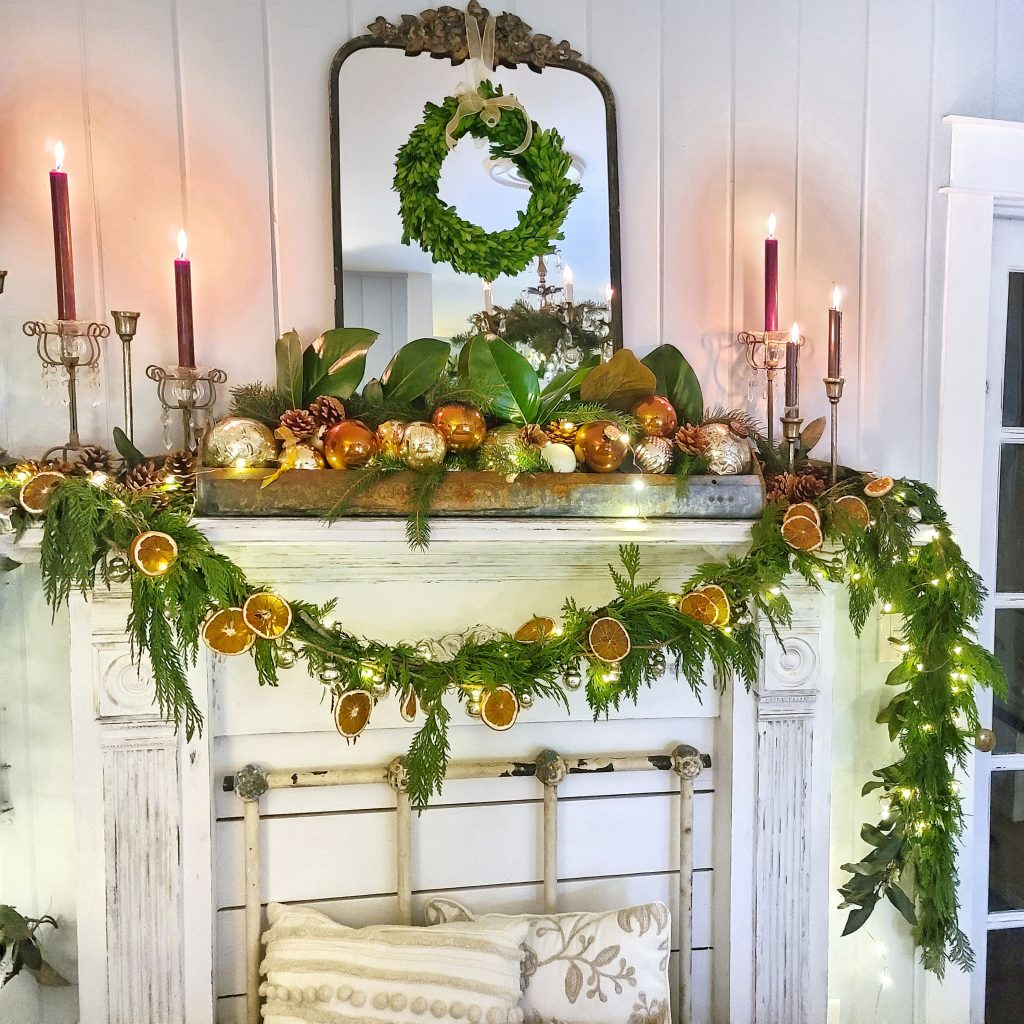 garland and twinkle lights on mantel