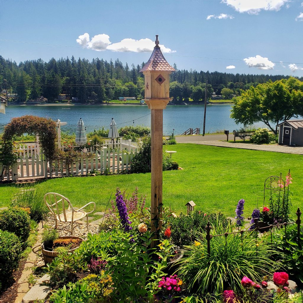birdhouse in a cottage garden overlooking the Puget Sound