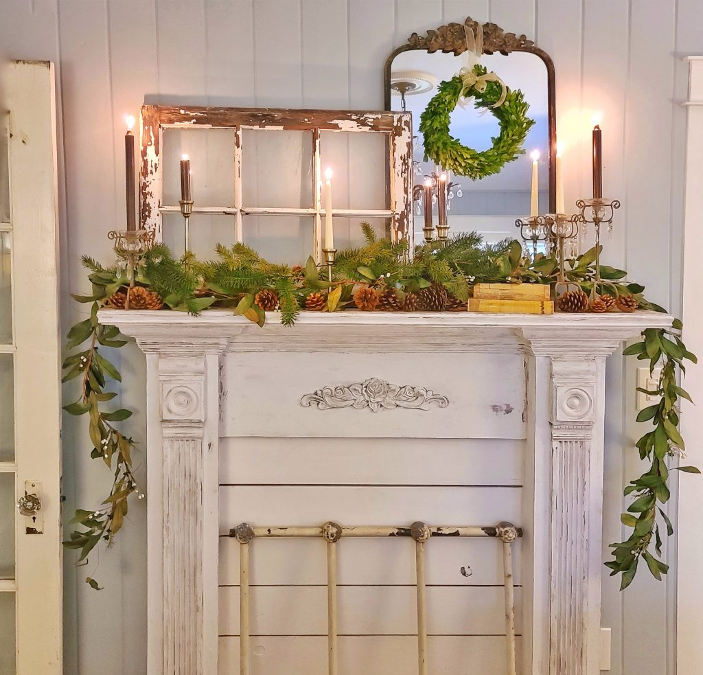Winter decor and greenery on a fireplace mantel