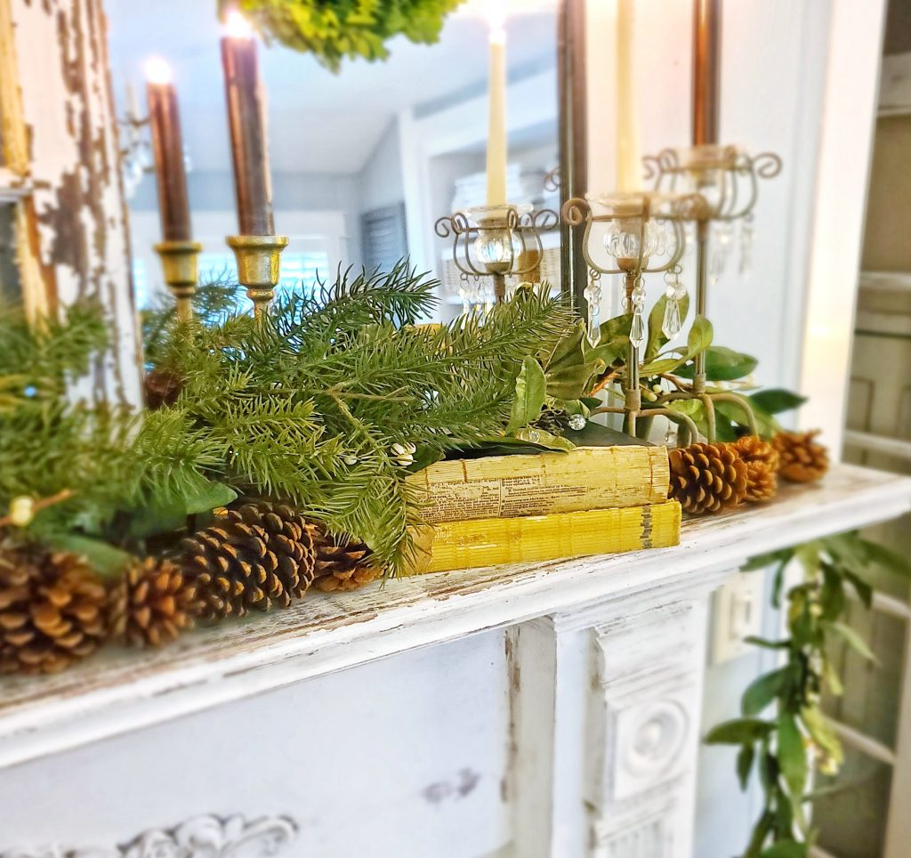 winter greenery and pinecones on fireplace mantel